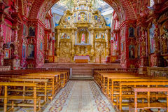 QUITO, ECUADOR - NOVEMBER 23, 2016: Interior of the Church of Santo Domingo, with chairs an spiritual images royalty free stock photography
