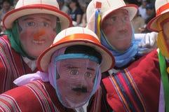 People in traditional Ecuadorean masks Stock Photo