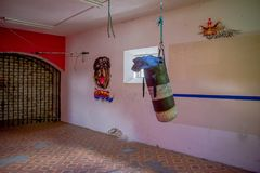 QUITO, ECUADOR - NOVEMBER 23, 2016: A sand bag inside of the old deserted rugged building, with some art in walls, in Royalty Free Stock Images