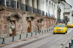 QUITO, ECUADOR NOVEMBER, 28, 2017: Some cars at historical center, in the streets of old town Quito in northern Ecuador. In the Andes mountains Stock Photos