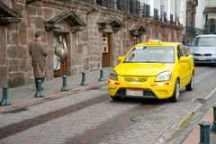 QUITO, ECUADOR NOVEMBER, 28, 2017: Some cars at historical center, in the streets of old town Quito in northern Ecuador. In the Andes mountains Royalty Free Stock Images