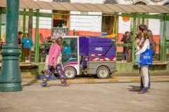 QUITO, ECUADOR - NOVEMBER 23, 2016: Unidentified couple walking in Historic Plaza de Santo Domingo, while a clean car is stock photography