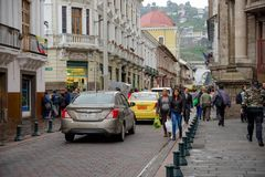 QUITO, ECUADOR NOVEMBER, 28, 2017: Unidentified people walking at historical center with some cars in the streets of old. Town Quito in northern Ecuador in the Royalty Free Stock Photos