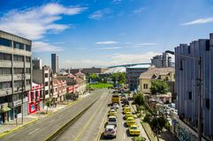 QUITO, ECUADOR - OCTOBER 23, 2017: Aerial view of view of some old buildings with many cars parked at outdoors in the. City of Quito, Ecuador royalty free stock photo