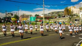 QUITO, ECUADOR - OCTOBER 23, 2017: Group of young school students girls in the march in the Quito Festivities` parade Royalty Free Stock Photos
