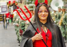 Quito, Ecuador - September, 03, 2018: Close up of unidentified woman wearing a demon costume and holding in her hand a stock image