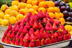 Quito, Ecuador - Strawberries, Plums And Peaches At A Market In Quito Royalty Free Stock Photo