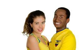 QUITO EKWADOR, MAJ, - 06, 2017: Młoda ecuadorian para jest ubranym oficjalną Maratońską futbolową koszulową trwanie okładzinową k Obraz Royalty Free