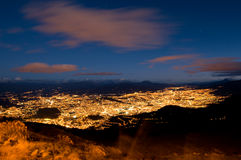 Quito at night with cotopaxi mountain. Quito, Ecuador at night aerial view Royalty Free Stock Images