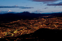 Quito at night with cotopaxi mountain. Quito, Ecuador at night aerial view Royalty Free Stock Image