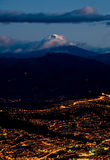 Quito at night with cotopaxi mountain. Quito, Ecuador at night aerial view Stock Image