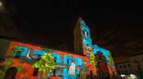 Quito, Pichincha Ecuador - August 9 2017: Close up of spectacle of lights projected on the facade of Church of Santo. Domingo, with some yellow iguana, rocks Stock Photo
