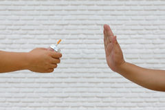 Quitting smoking concept. Hand is refusing cigarette offer. Royalty Free Stock Photography
