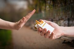 Quitting smoking concept. Hand is rejecting cigarette offer Stock Photography