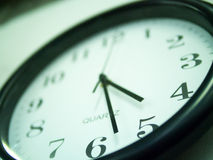 Almost Quitting time. A view of a wall clock at almost quitting time of 4:30 Stock Image