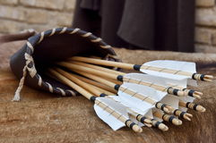 Quiver. Ancient quiver with arrows over the table Stock Photography