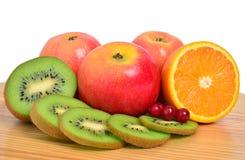 Quivi, maçãs, laranja e airela Foto de Stock Royalty Free