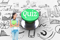 Quiz against digitally generated green push button. The word quiz and student holding notepads against digitally generated green push button royalty free stock images