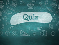 Quiz against green chalkboard. The word quiz and school graphics against green chalkboard Stock Images