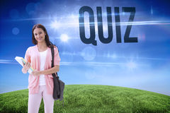 Quiz against green hill under blue sky Stock Photo