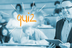 Quiz against lecturer standing in front of his class in lecture hall Stock Photo