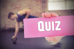 Quiz against people background Stock Photo