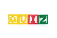 Quiz - Alphabet Baby Blocks on white. Quiz spelled out using baby blocks / colorful alphabet wood blocks stock photo