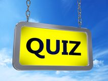 Quiz on billboard. Quiz on yellow light box billboard on blue sky background Royalty Free Stock Images
