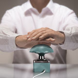 Quiz Game Buzzer. Image compositing between photography and 3D buzzer. Man with two hands about to press the button for answering a quiz question Royalty Free Stock Photography