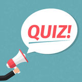 Quiz. Hand with megaphone and speech bubble with word Quiz Stock Image