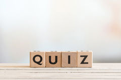 Quiz sign on a wooden table