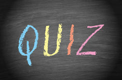 Quiz - text on chalkboard background Royalty Free Stock Photos