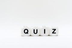 Quiz, Würfelbuchstaben Stockfotografie