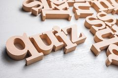 Quiz Wood Word. QUIZ word by wood alphabet scattered on the wood table stock images
