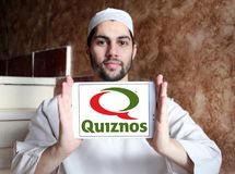 Quiznos fast food restaurant logo. Logo of Quiznos fast food restaurant on samsung tablet holded by arab muslim man. Quiznos, is a franchised fast-food stock photography