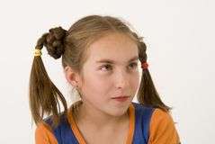Quizzical glance. The nice girl-teenager archly looking  up Stock Images