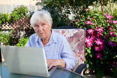 QUizzical Senior Woman with Computer Royalty Free Stock Image