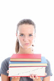 Quizzical student carrying textbooks Royalty Free Stock Images