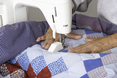 Qulter machine quilting patriotic quilt. Royalty Free Stock Photography