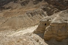 Qumran Cave with the dead sea royalty free stock image