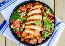 Qunioa salad with grilled chicken. Corn basil and cherry tomatoes royalty free stock photography