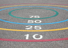 Quoits game with winning circles on asphalt Royalty Free Stock Images