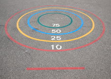 Quoits game with winning circles and baseline on asphalt Royalty Free Stock Photo