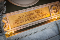 Quotation Above Window in Library of Congress. Too low they build who build beneath the stars: one of many inspirational quotes found inside the Library of royalty free stock photo
