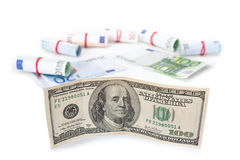 The quotation of the dollar grew against the euro. Banknotes on a white background. Royalty Free Stock Photos