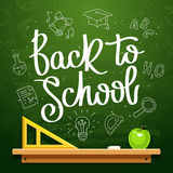 Quote. Back to school. The trend calligraphy. Vector illustration on a green chalkboard with the school contour icons, apple and a triangle. Card for the stock illustration