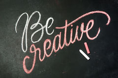 Quote - Be creative on black chalkboard handwritten by color chalks Royalty Free Stock Photos