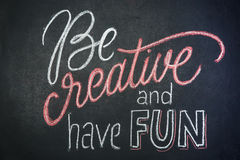 Quote - Be creative and have fun- on black chalkboard handwritten by color chalks Royalty Free Stock Photography