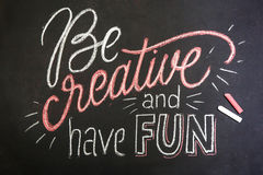 Quote - Be creative and have fun- on black chalkboard handwritten by color chalks Royalty Free Stock Images