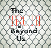 Quote Behind Fence: The Truth is Beyond Us Royalty Free Stock Photography